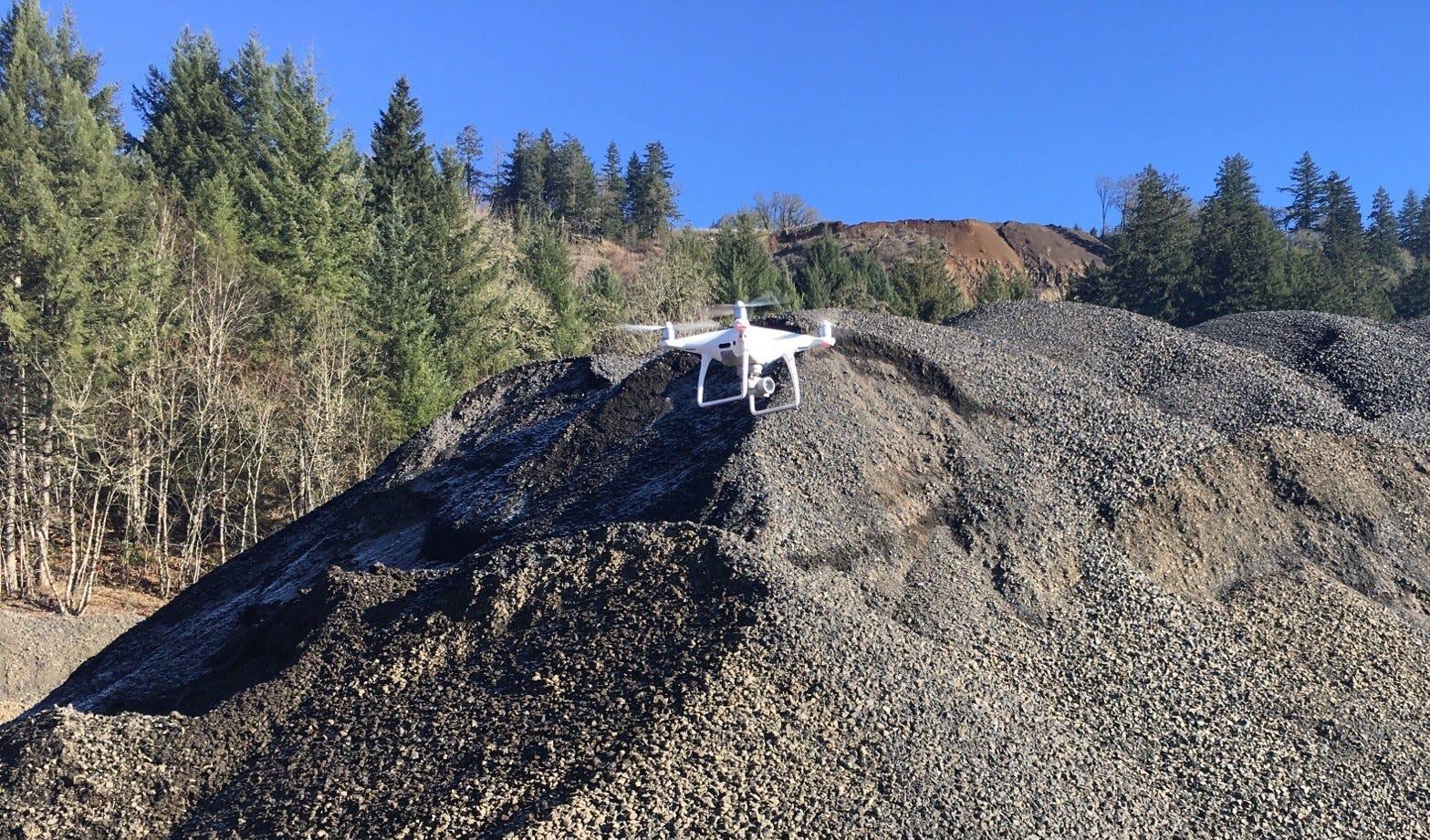 A Siegmund Excavation drone surveys a rock quarry.