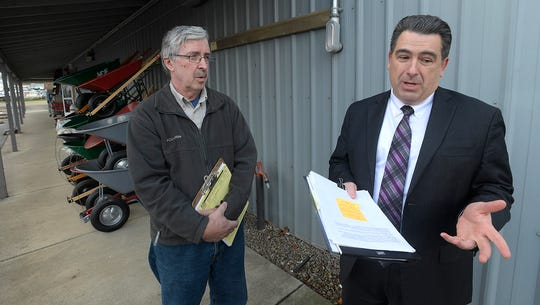 Linn County is Linn County District Attorney Doug Marteeny and Economy Supply co-owner Richard Micklewright.