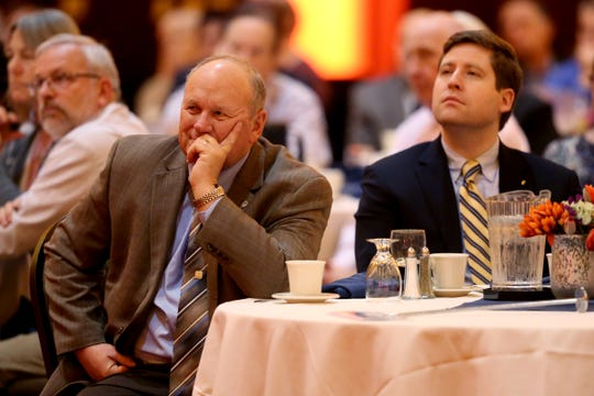Marion County Commissioners Sam Brentano, left, and Colm Willis listen as Mayor Chuck Bennett gives the State of the City address at the Salem Convention Center in Salem on Wednesday, Jan. 23, 2019.