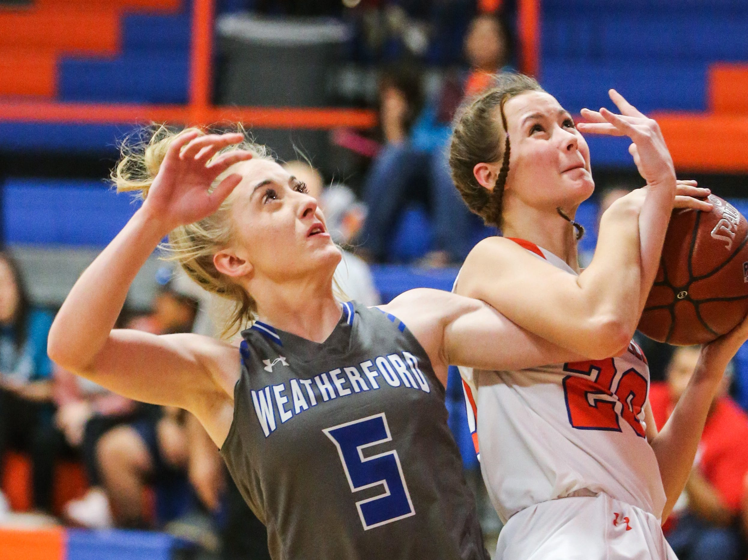 Central's Anjelina Humphreys gets tangled with Weatherford player as she tries to shoot Tuesday, Jan. 22, 2019, at Central High School.