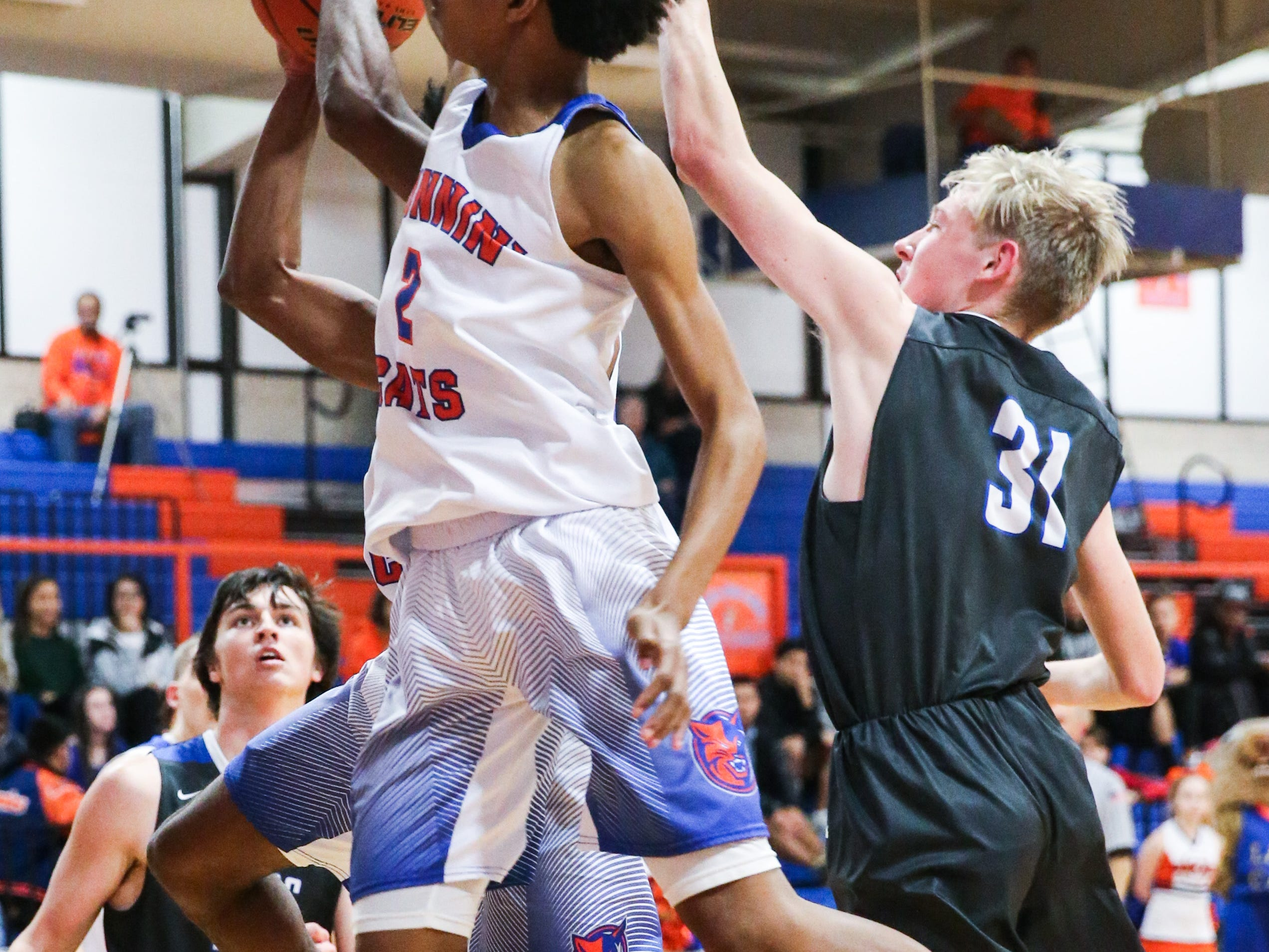 Central's Deveraux Minix jumps for the rebound against Weatherford Tuesday, Jan. 22, 2019, at Central High School.