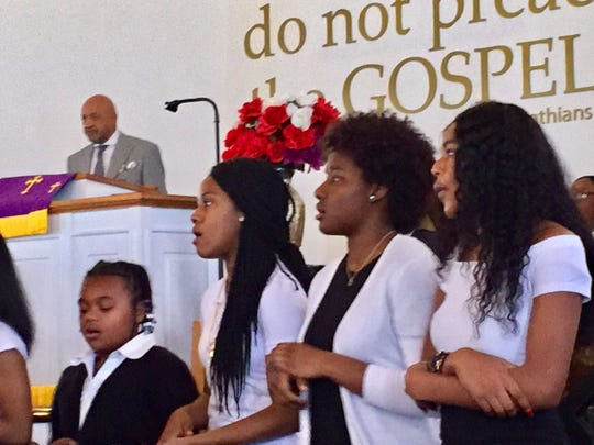 Members of the First Baptist Church in Capeville sing at the celebration Sunday.