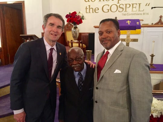 Gov. Ralph Northam, left, is pictured with church deacon Charles Bell, center, and Pastor the Rev. Kelvin F. Jones after the Rev. Dr. Martin Luther King  celebration service at First Baptist Church in Capeville.