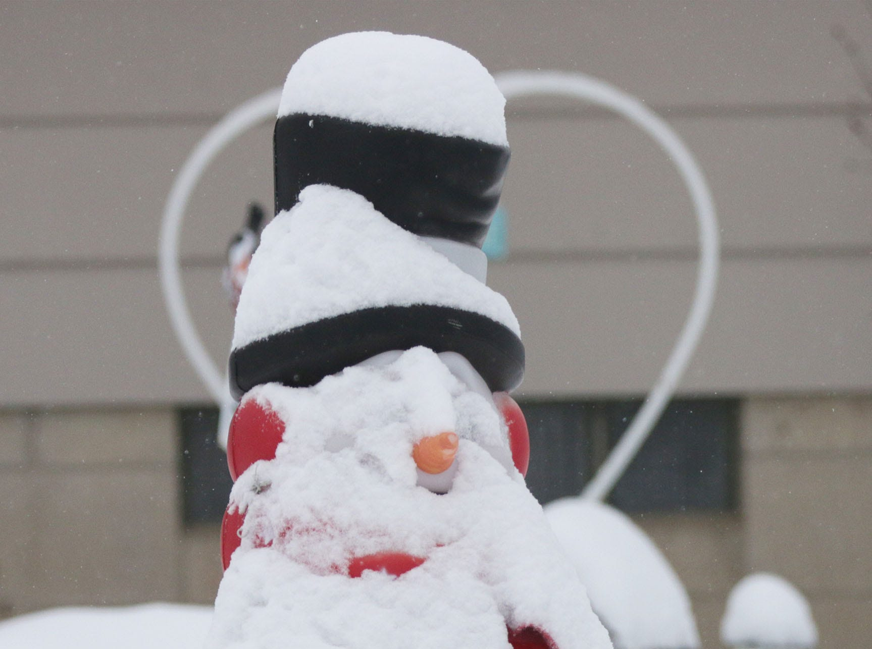 A snow man on Sheboygan's south side has a fresh coat of snow, Wednesday, January 23, 2019, in Sheboygan, Wis.