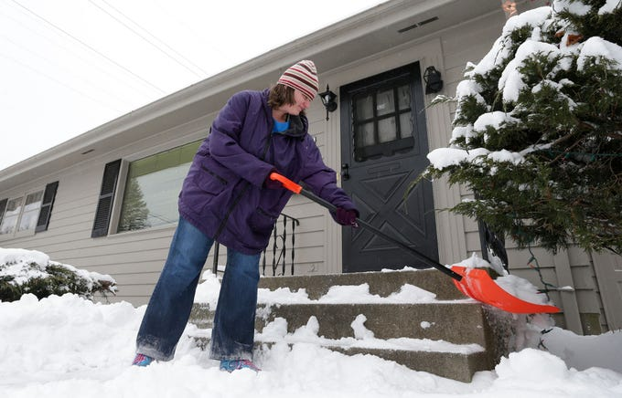 Michelle Carle of Sheboyganworks on shoveling snow from steps on Ashland Avenue near South 8th Street, Wednesday, January 23, 2019, in Sheboygan, Wis.