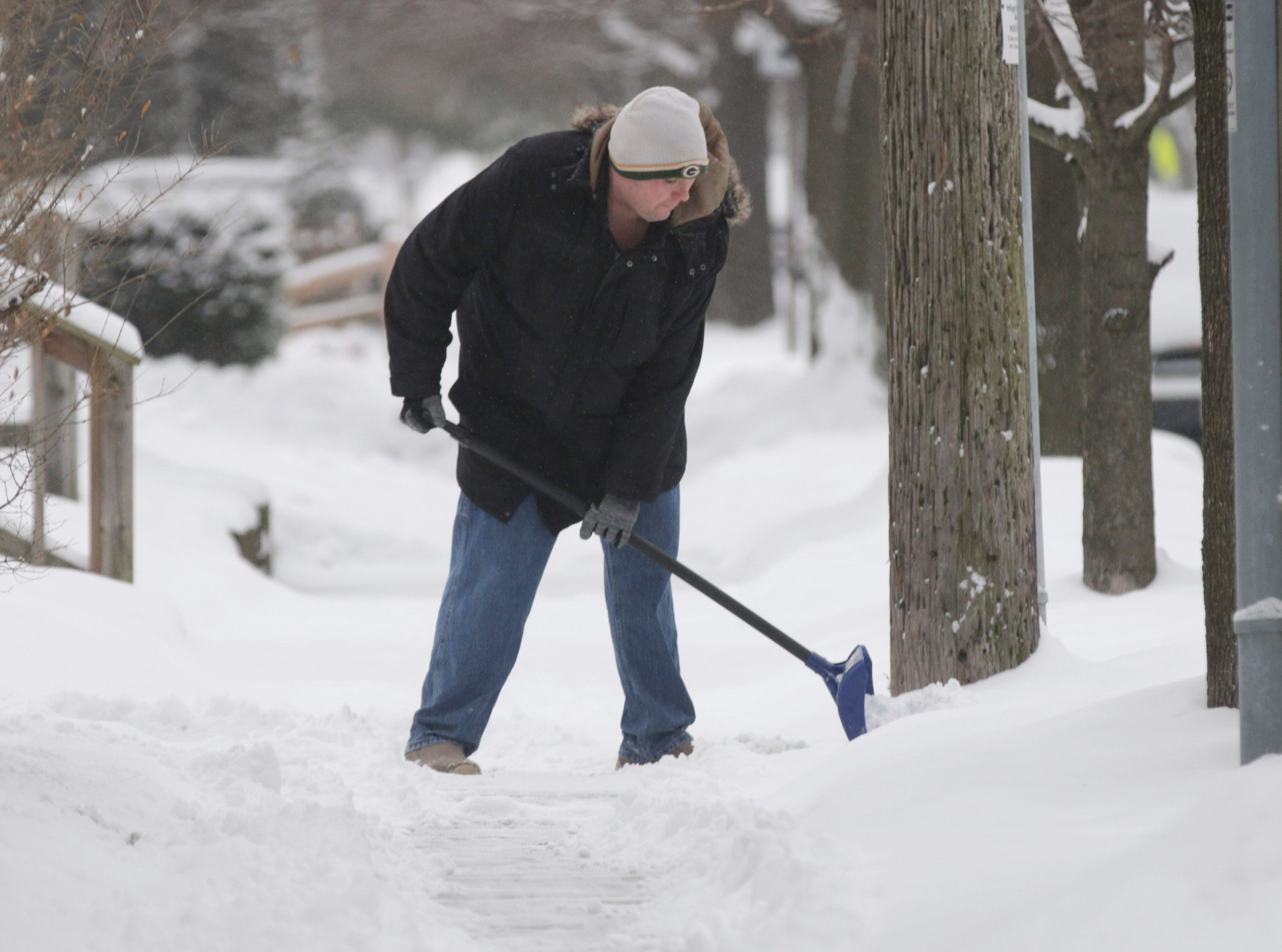 Billy Poedter of Sheboygan shovels snow on his sidewalk, Wednesday, January 23, 2019, in Sheboygan, Wis.