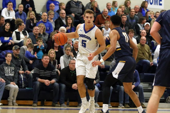 Mitchell Goodbary of Sioux Falls Christian looks to dribble past Justin Hohn of Tea Area during Tuesday night's game in Sioux Falls.
