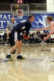 Noah Freidel of Tea Area looks to get past Gavin Schipper of Sioux Falls Christian during Tuesday night's game in Sioux Falls.
