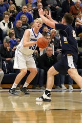 Zach Witte of Sioux Falls Christian pulls up for a shot from the corner as Kaleb Joffer of Tea Area defends during Tuesday's game in Sioux Falls.