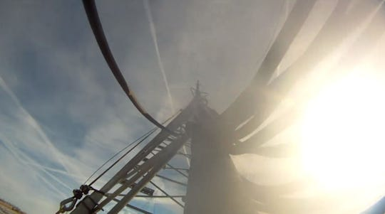 A screenshot captures the last moments of a 400-foot tower near Toronto as Sioux Falls Tower and Communications dropped the tower into an open field, an event not often caught on video.