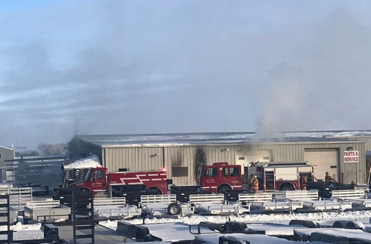 Smoke billows from Dell Rapids Custom Trailers after a fire broke out at the business on Wednesday, Jan. 23, 2019.