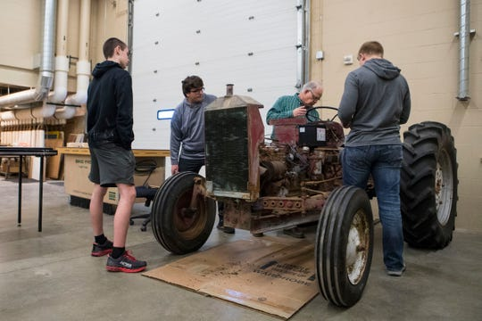 Todd Marks teaches Josiah Scheaffer (left), Daniel Willems and Colt Harder how to repair a tractor during agriculture mechanics class at Harrisburg High School, Wednesday, Jan. 23, 2019 in Harrisburg, S.D.