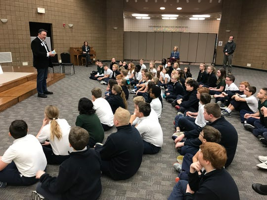 """South Dakota children's book author Tom Roberts reads from his book """"A New Norm"""" at St. Michael School."""