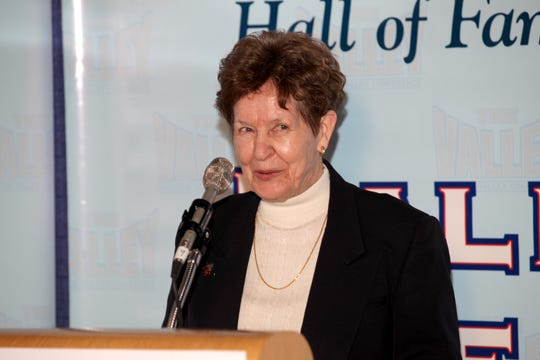 Mary Jo Wynn speaks at  the Missouri Valley Conference at the conference's annual Presidents' Hall of Fame Brunch in St. Louis in June 2012.