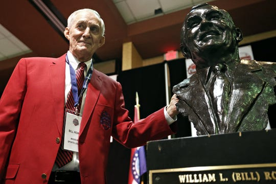 Bill Rowe poses for a portrait with a bust commissioned in his honor during the Missouri Sports Hall of Fame 2016 Sports Enthusiasts Baseball Luncheon at the University Plaza Convention Center in Springfield, Mo. on May 18, 2016. Rowe, a longtime Missouri State athletic director, was honored as a Missouri Sports Legend at the event.
