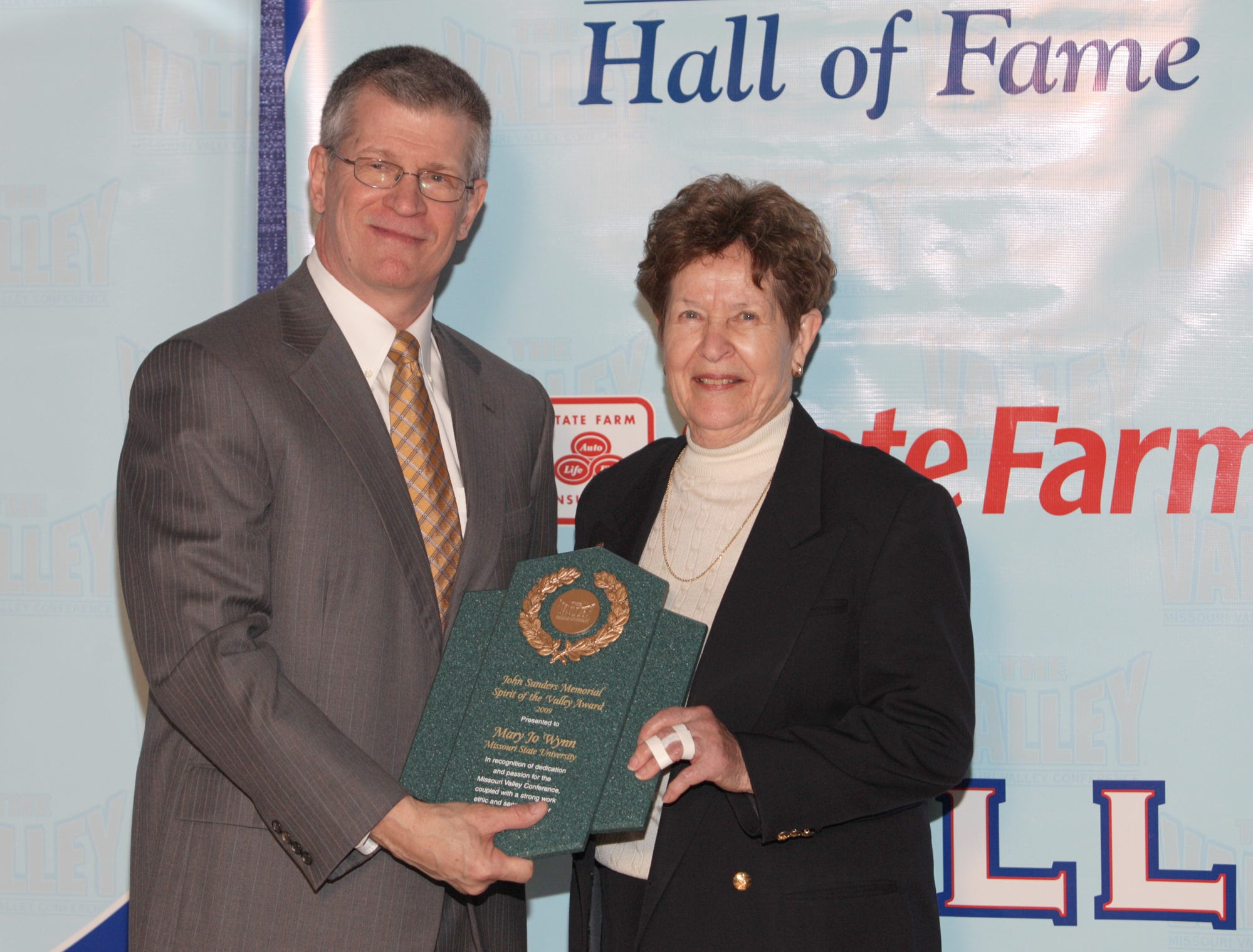 MVC Commissioner Doug Elgin stands with Former Missouri State University of Women's Athletic Dr. Mary Jo Wynn at the MVC Hall of Fame induction in 2013.