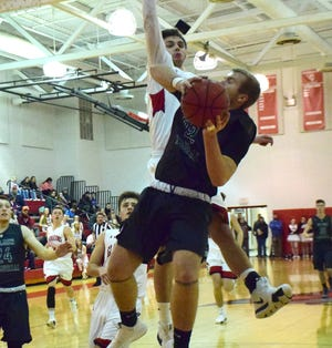 Wilson Memorial's Matt Poole goes up for a shot as Riverheads' Drew Bond defends during the first half of their Shenandoah District boys basketball game on Tuesday, Jan. 22, 2019, at Riverheads High School in Greenville, Va.