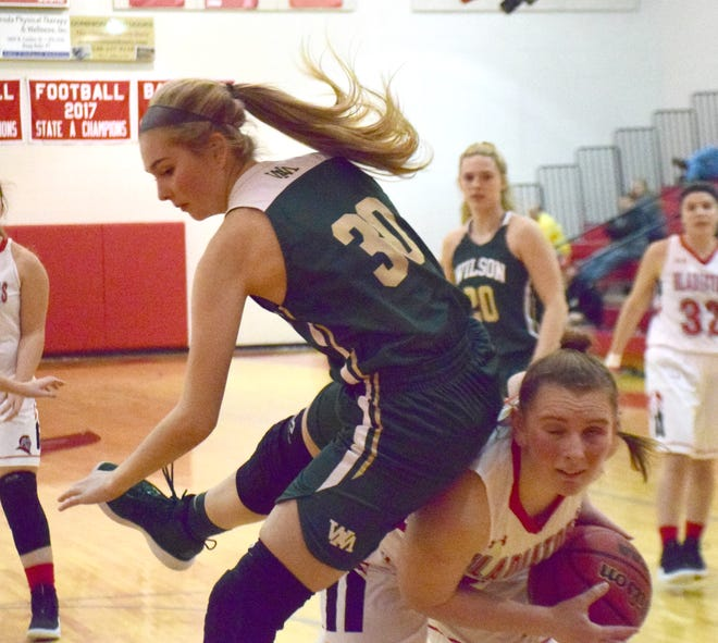 Riverheads' Dayton Moore, right, is fouled by Wilson Memorial's Korinne Baska during the first half of their Shenandoah District girls basketball game on Tuesday, Jan. 22, 2019, at Riverheads High School in Greenville, Va.