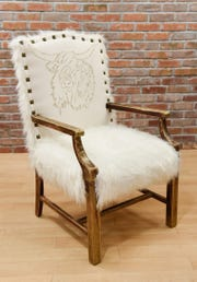 A unique chair upholstered by Ashley Green, Green Thumb Etc., shown Tuesday, Jan. 22, at her new store in 912 Regency Plaza.