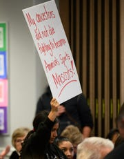 """The Iron County School Board listens to presentations about keeping or changing the Cedar High School """"Redmen"""" mascot at a board meeting in the district building Tuesday, January 22, 2019. After both presentations and more than 45 minutes of public comments, the board did not announce when they would vote on the issue."""
