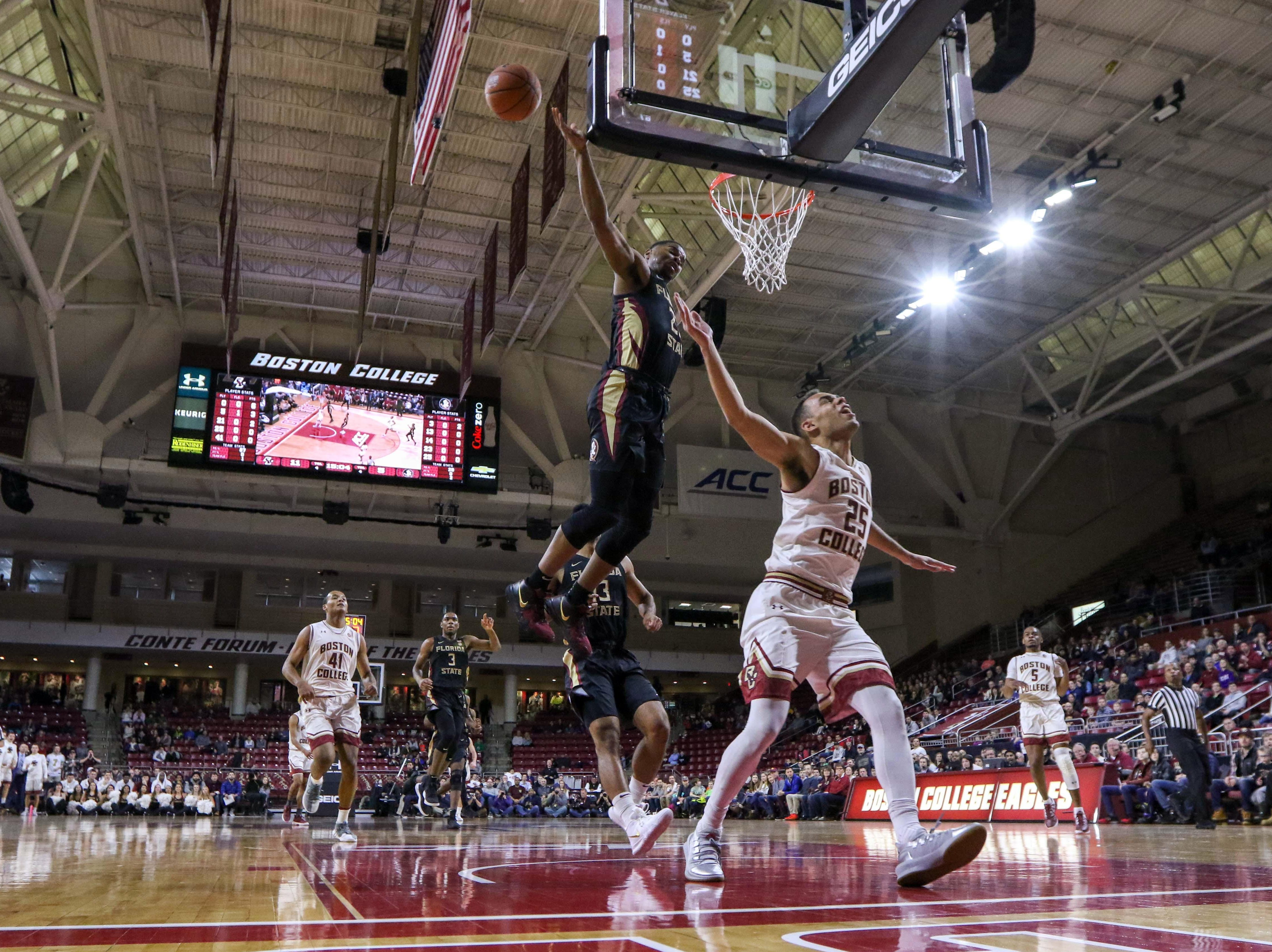 Jan 20, 2019; Chestnut Hill, MA, USA; Florida State Seminoles guard M.J. Walker (23) blocks a shot attempt by Boston College Eagles guard Jordan Chatman (25) during the first half at Conte Forum. Mandatory Credit: Paul Rutherford-USA TODAY Sports