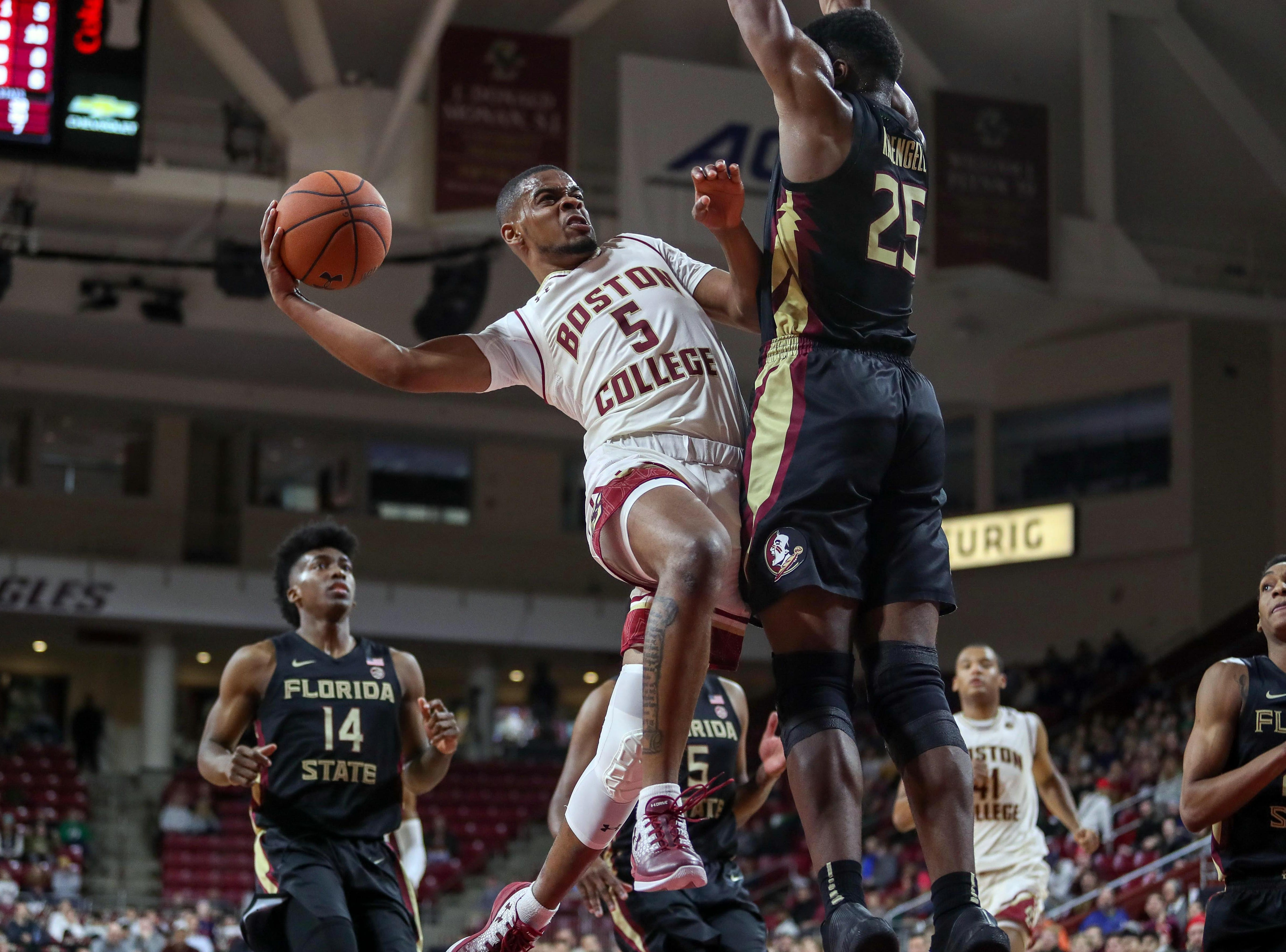 Jan 20, 2019; Chestnut Hill, MA, USA; Boston College Eagles guard Wynston Tabbs (5) shoots against Florida State Seminoles forward Mfiondu Kabengele (25) during the first half at Conte Forum. Mandatory Credit: Paul Rutherford-USA TODAY Sports