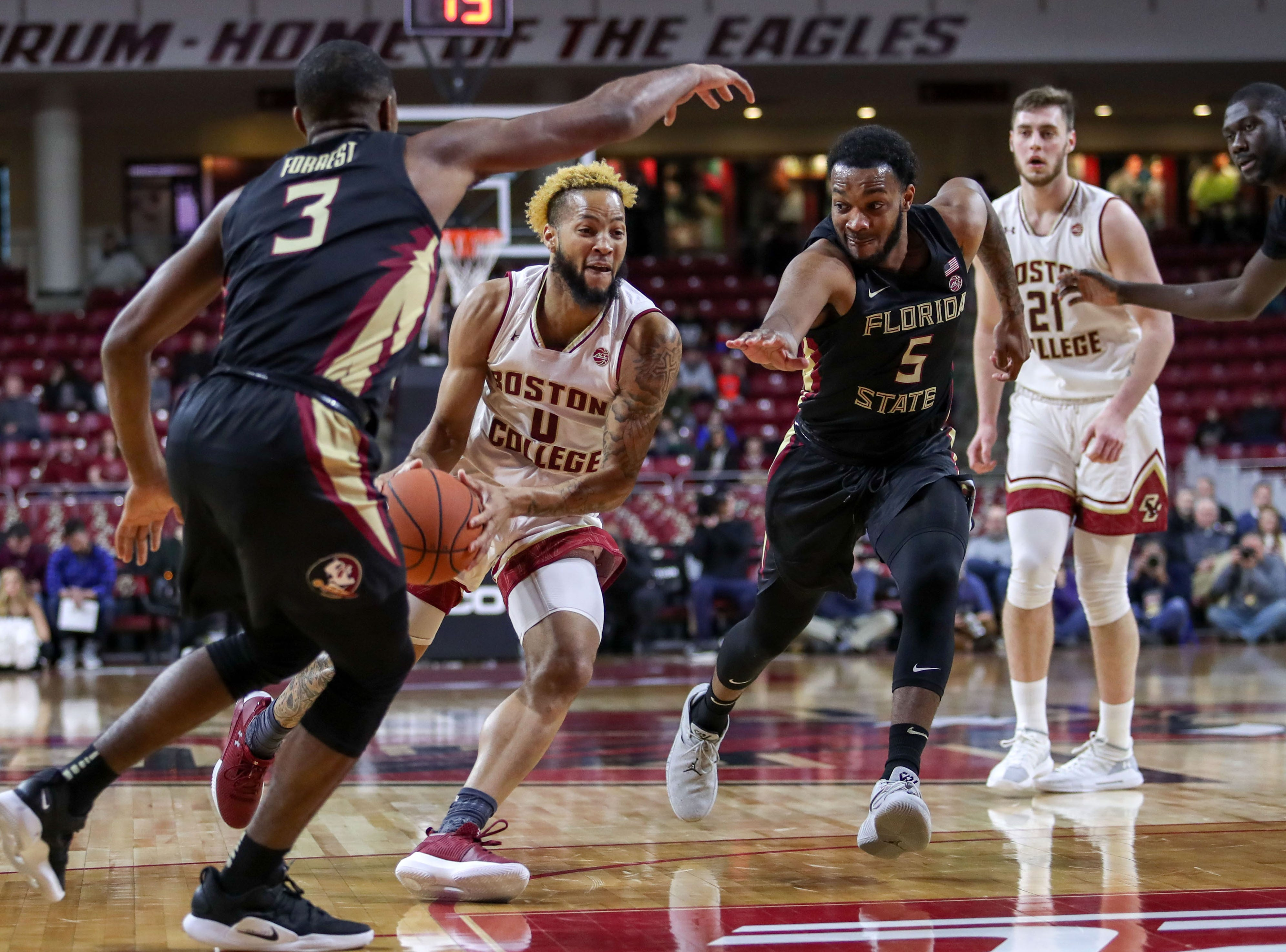 Jan 20, 2019; Chestnut Hill, MA, USA; Boston College Eagles guard Ky Bowman (0) drives to the basket against the Florida State Seminoles during the first half at Conte Forum. Mandatory Credit: Paul Rutherford-USA TODAY Sports