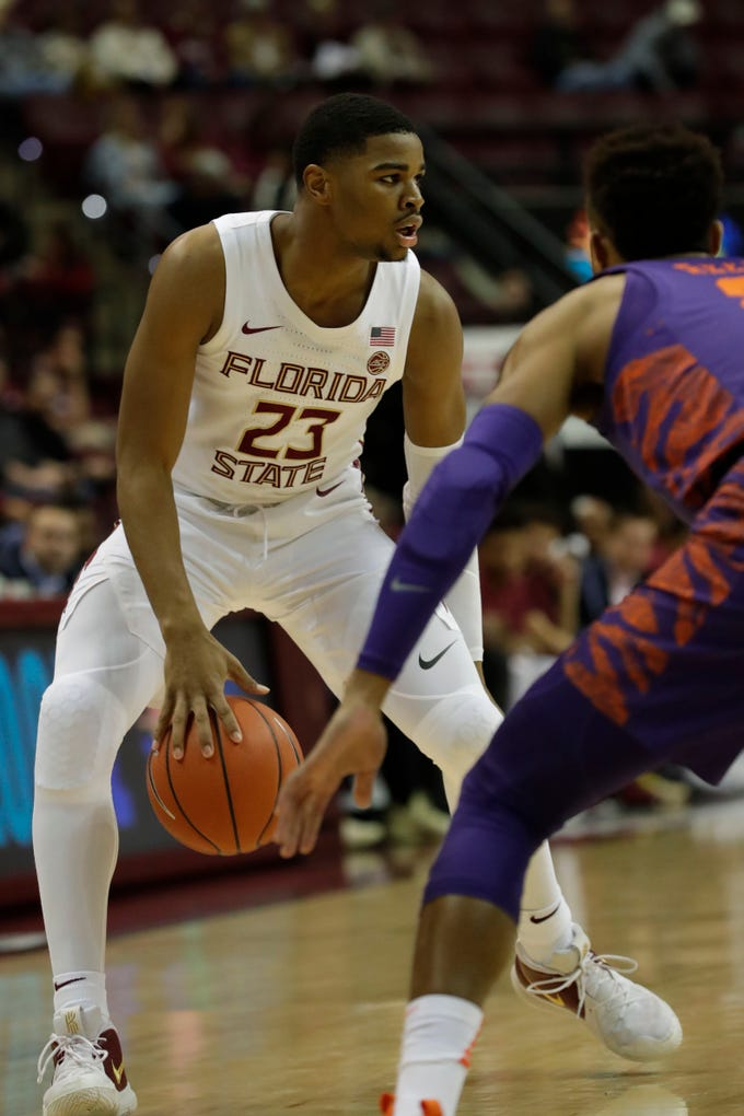 Florida State Seminoles guard M.J. Walker (23) looks for a way around his defender. The Florida State Seminoles face off against the Clemson Tigers at the Tucker Civic Center, Tuesday, Jan. 22, 2019.
