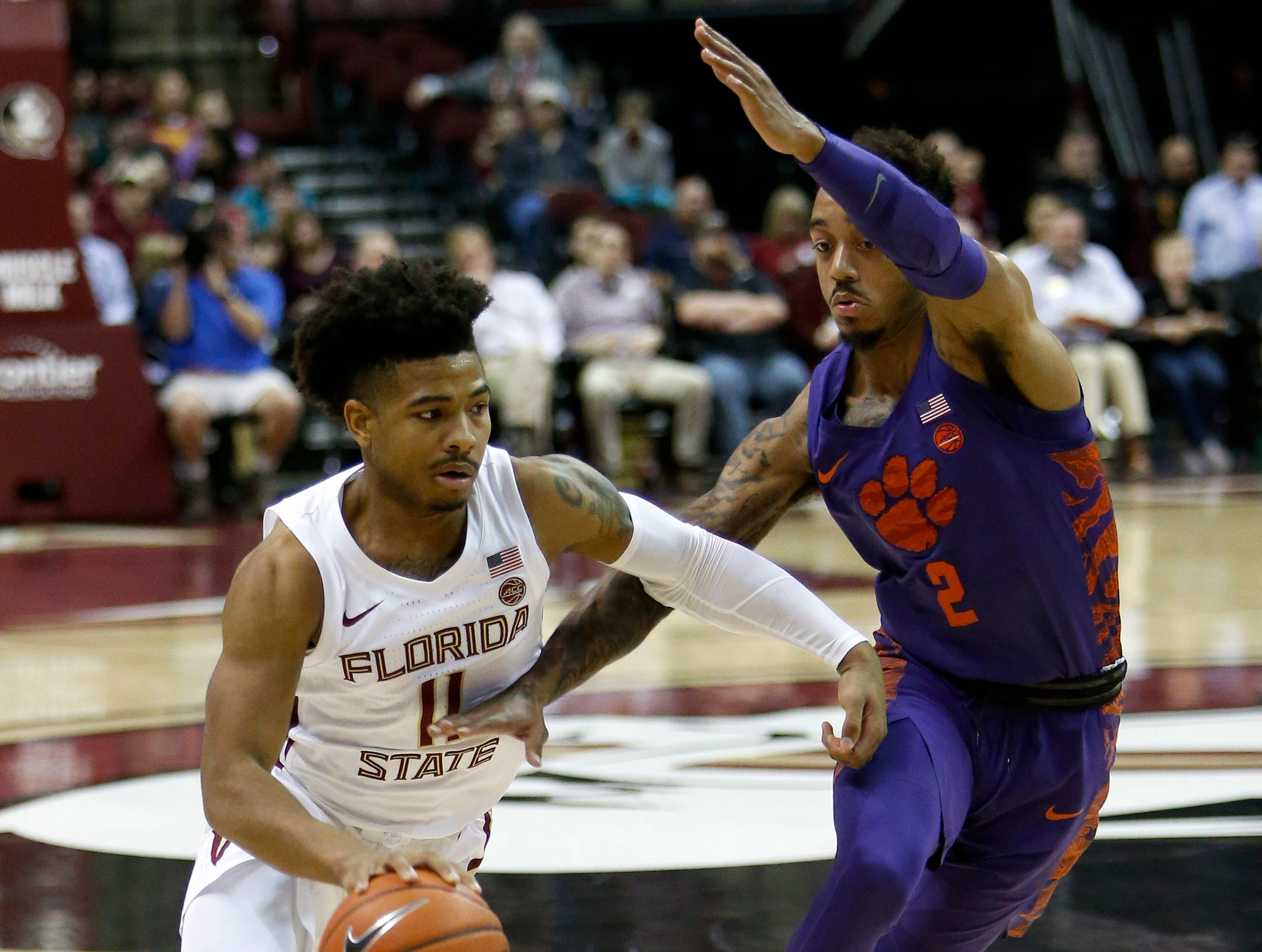 Jan 22, 2019; Tallahassee, FL, USA; Florida State Seminoles guard David Nichols (11) drives against Clemson Tigers guard Marcquise Reed (2) during the first half at Donald L. Tucker Center. Mandatory Credit: Glenn Beil-USA TODAY Sports