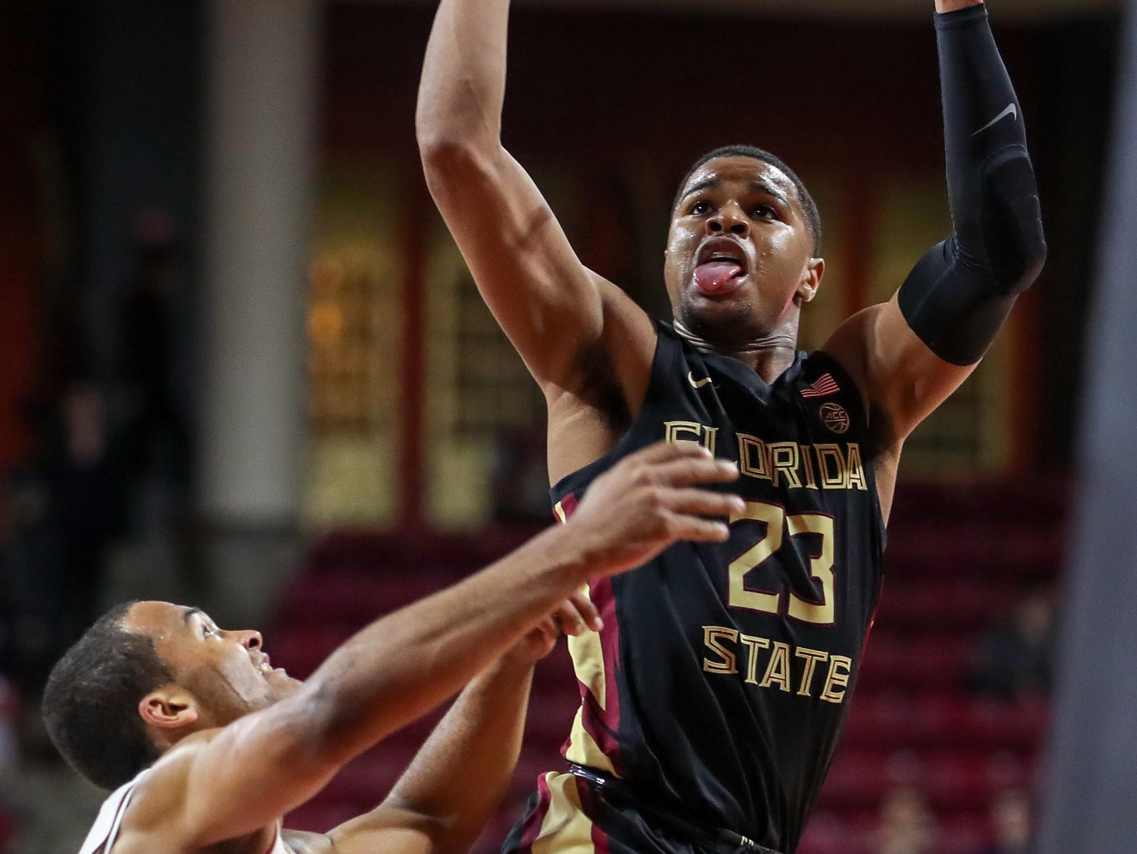 Jan 20, 2019; Chestnut Hill, MA, USA; Florida State Seminoles guard M.J. Walker (23) shoots against Boston College Eagles forward Steffon Mitchell (41) during the first half at Conte Forum. Mandatory Credit: Paul Rutherford-USA TODAY Sports