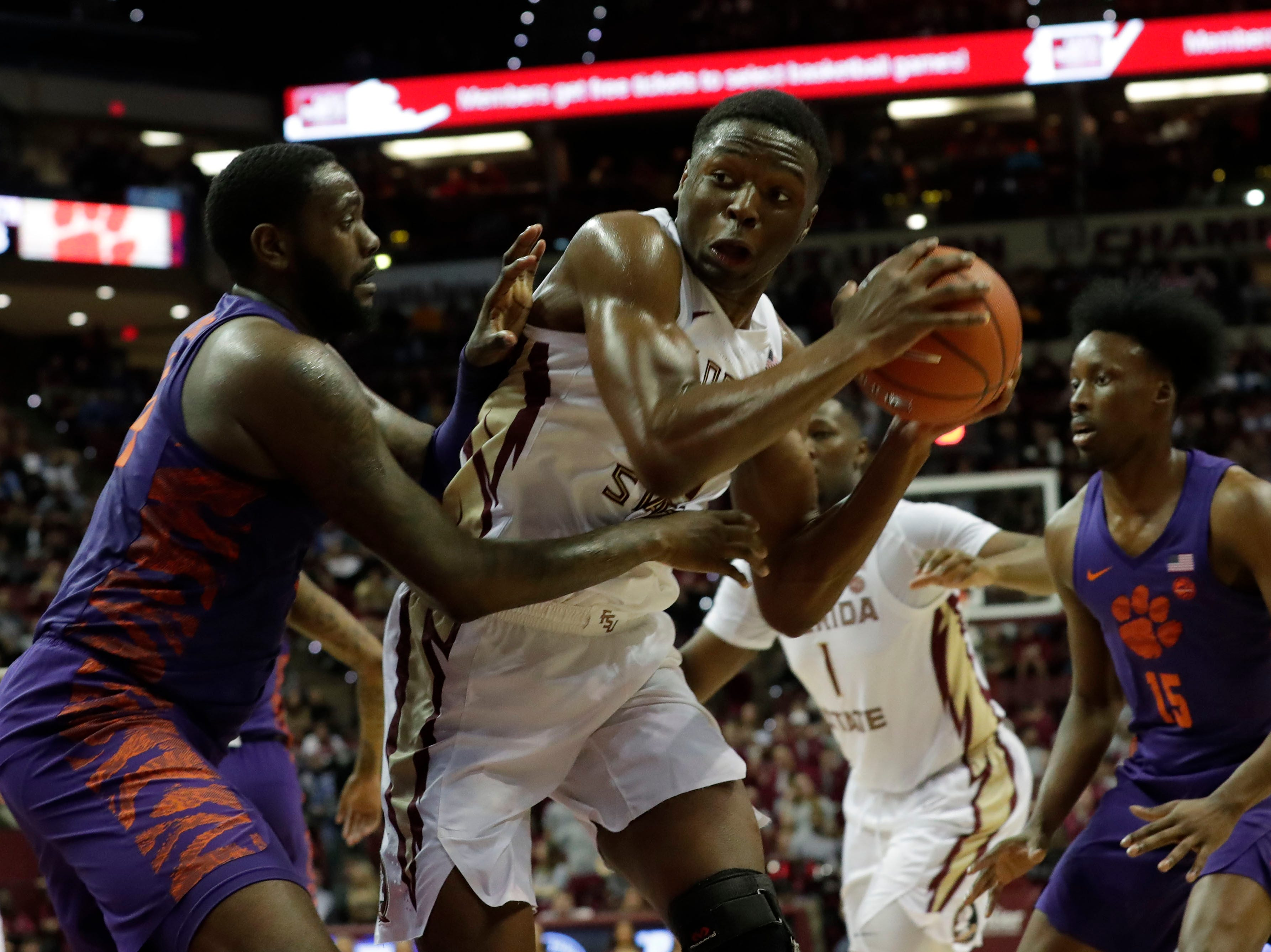 Florida State Seminoles forward Mfiondu Kabengele (25) fights a defender as he tries to shoot for two. The Florida State Seminoles face off against the Clemson Tigers at the Tucker Civic Center, Tuesday, Jan. 22, 2019.