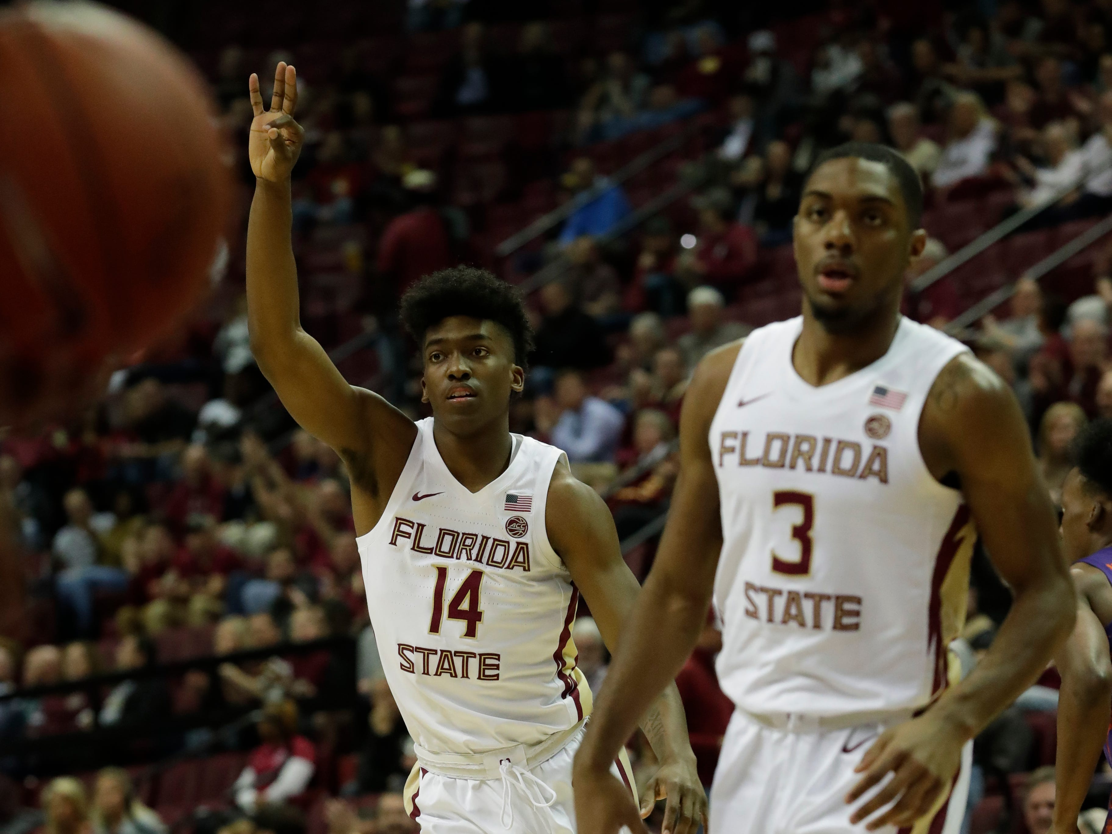 Florida State Seminoles guard Terance Mann (14) celebrates after his successful three-point shot. The Florida State Seminoles face off against the Clemson Tigers at the Tucker Civic Center, Tuesday, Jan. 22, 2019.