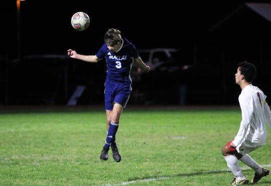 Maclay's Ryan Daunt heads a ball away from danger as Leon's boys soccer team beat Maclay 3-1 on Jan. 22, 2019.