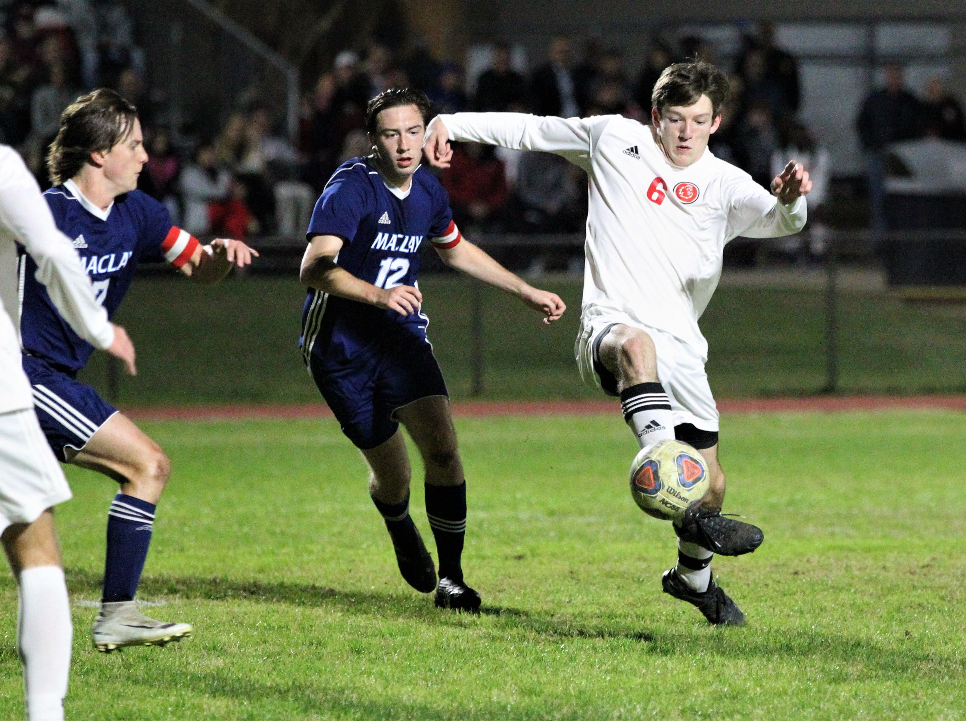 Leon's Tate Wallenfelsz plays a pass with the outside of his foot as Leon's boys soccer team beat Maclay 3-1 on Jan. 22, 2019.