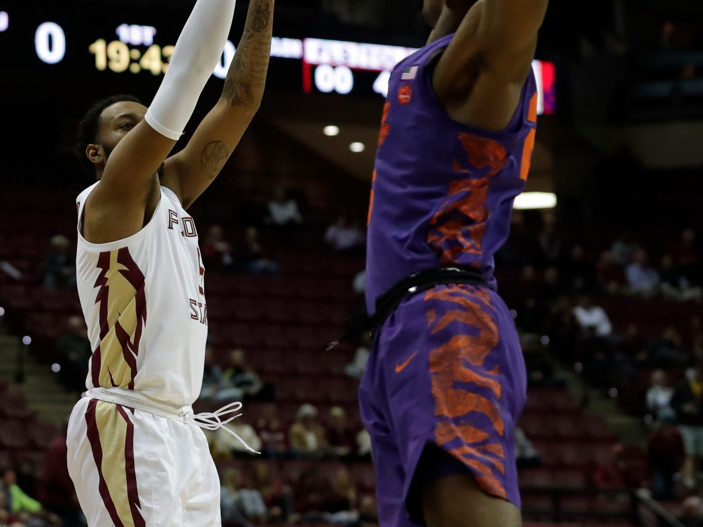 Florida State Seminoles guard PJ Savoy (5) shoots for two over his defender. The Florida State Seminoles face off against the Clemson Tigers at the Tucker Civic Center, Tuesday, Jan. 22, 2019.