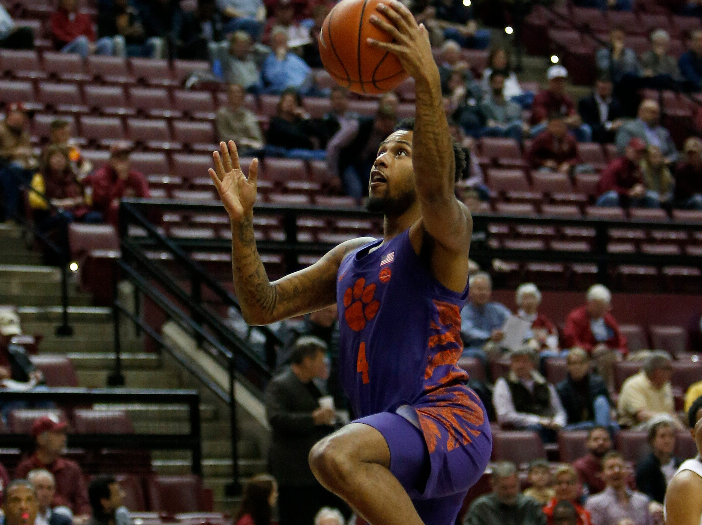 Jan 22, 2019; Tallahassee, FL, USA; Clemson Tigers guard Shelton Mitchell (4) scores on a layup against the Florida State Seminoles during the first half at Donald L. Tucker Center. Mandatory Credit: Glenn Beil-USA TODAY Sports