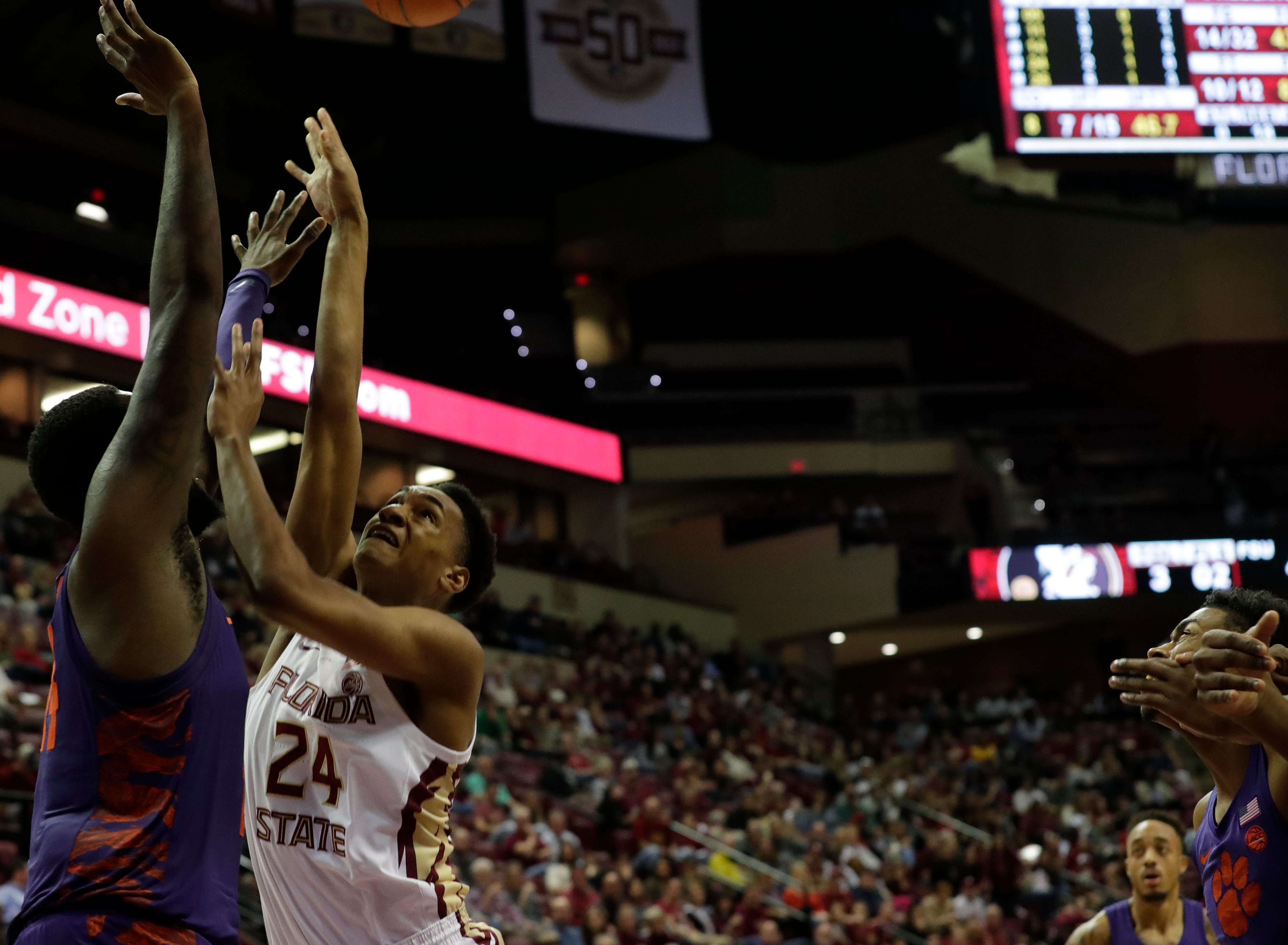 Florida State Seminoles guard Devin Vassell (24) fights for the rebound with a defender. The Florida State Seminoles face off against the Clemson Tigers at the Tucker Civic Center, Tuesday, Jan. 22, 2019.