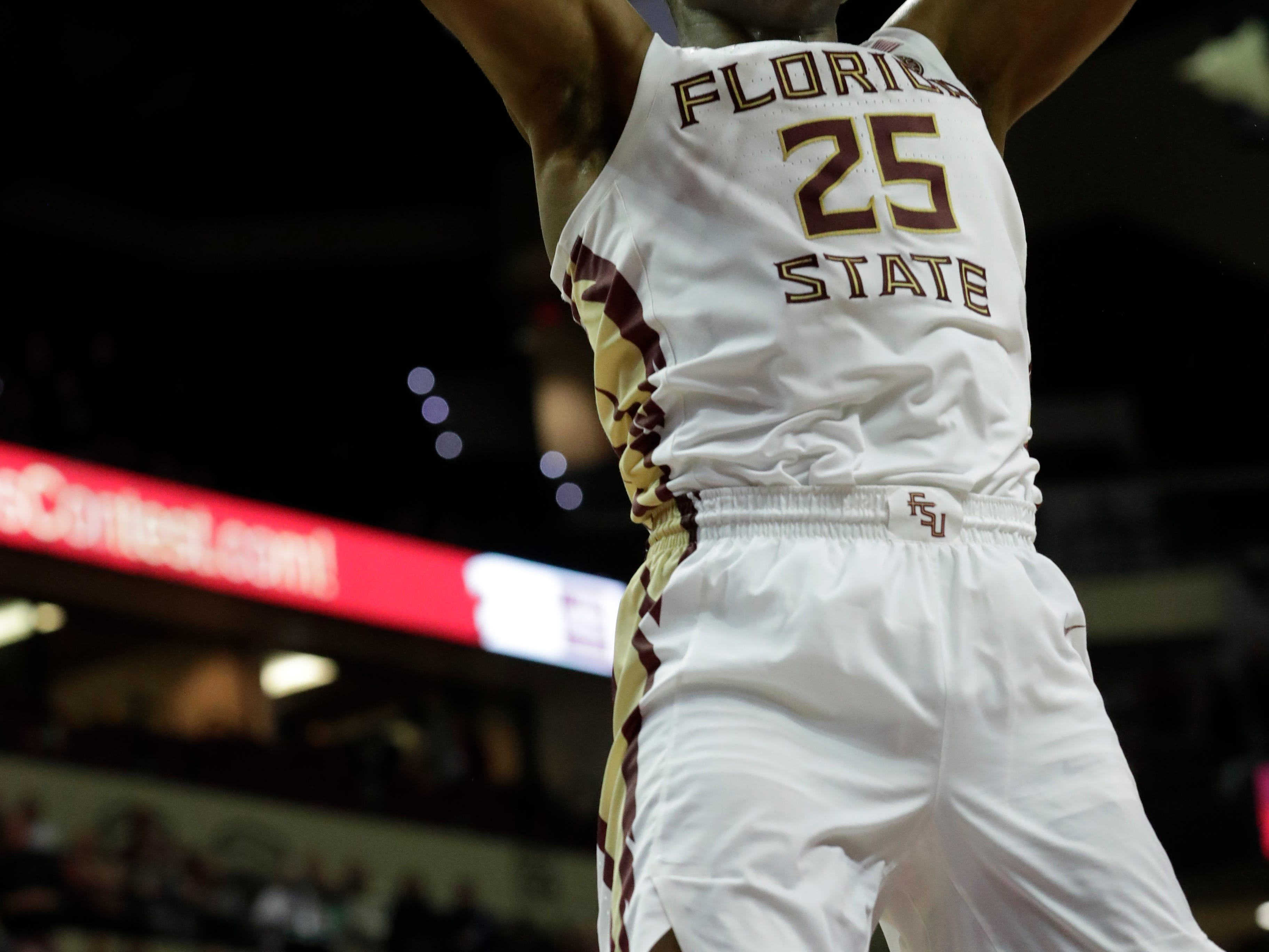 Florida State Seminoles forward Mfiondu Kabengele (25) slam dunks on the Tigers. The Florida State Seminoles face off against the Clemson Tigers at the Tucker Civic Center, Tuesday, Jan. 22, 2019.
