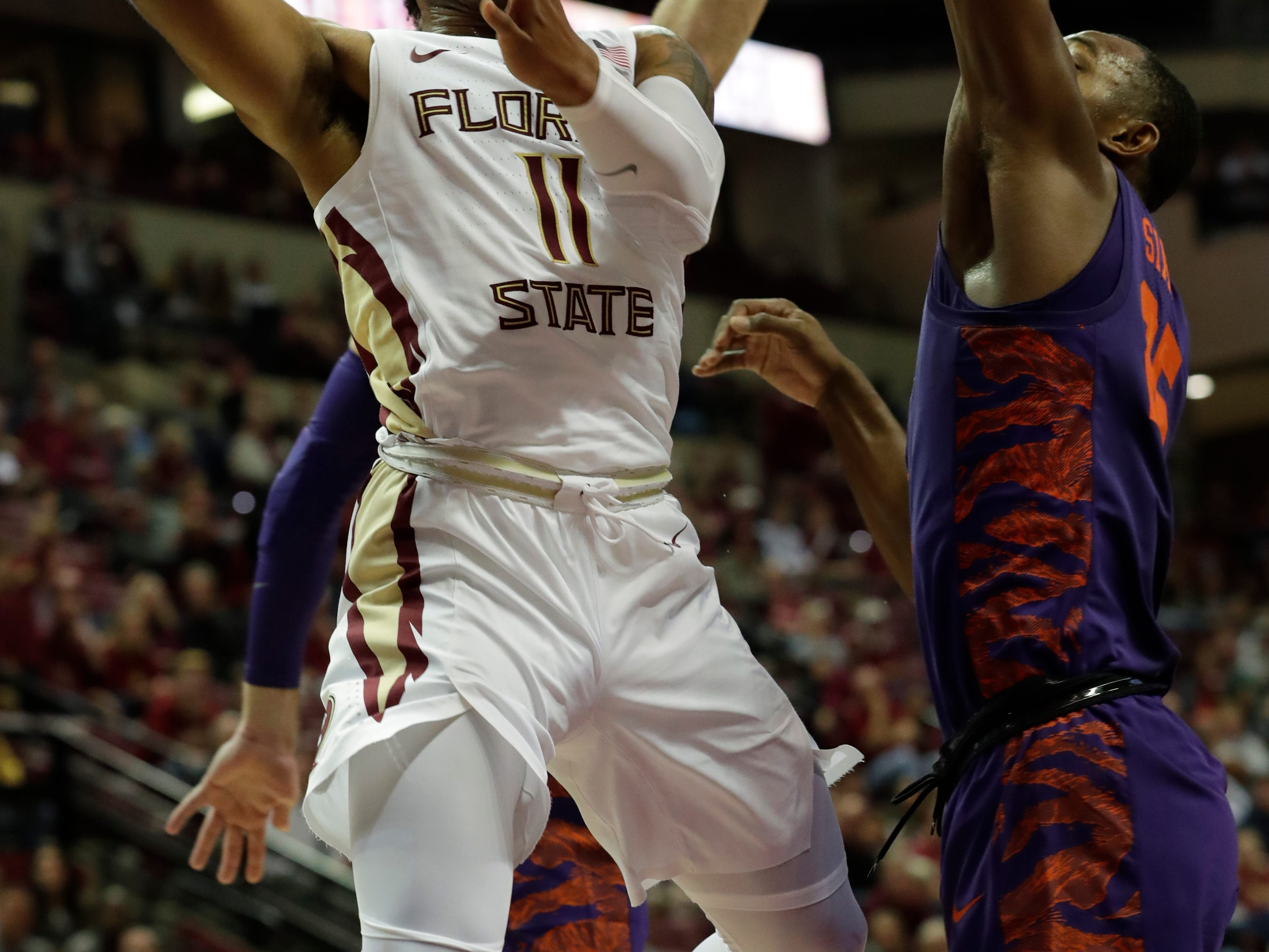 Florida State Seminoles guard David Nichols (11) gets around his defenders as he goes in for a layup. The Florida State Seminoles face off against the Clemson Tigers at the Tucker Civic Center, Tuesday, Jan. 22, 2019.