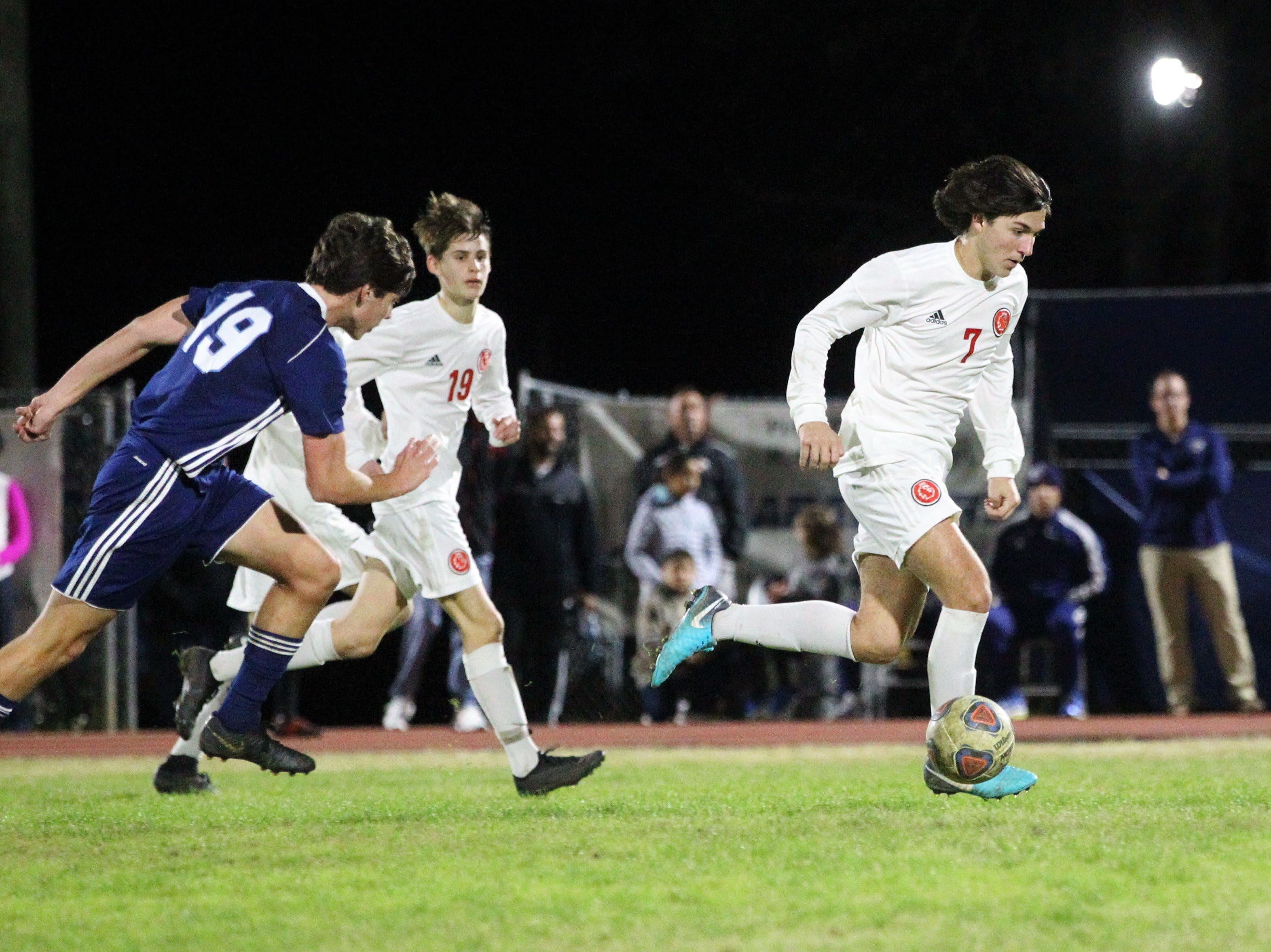 Leon's Henry Regalado dribbles through the midfield as  Leon's boys soccer team beat Maclay 3-1 on Jan. 22, 2019.