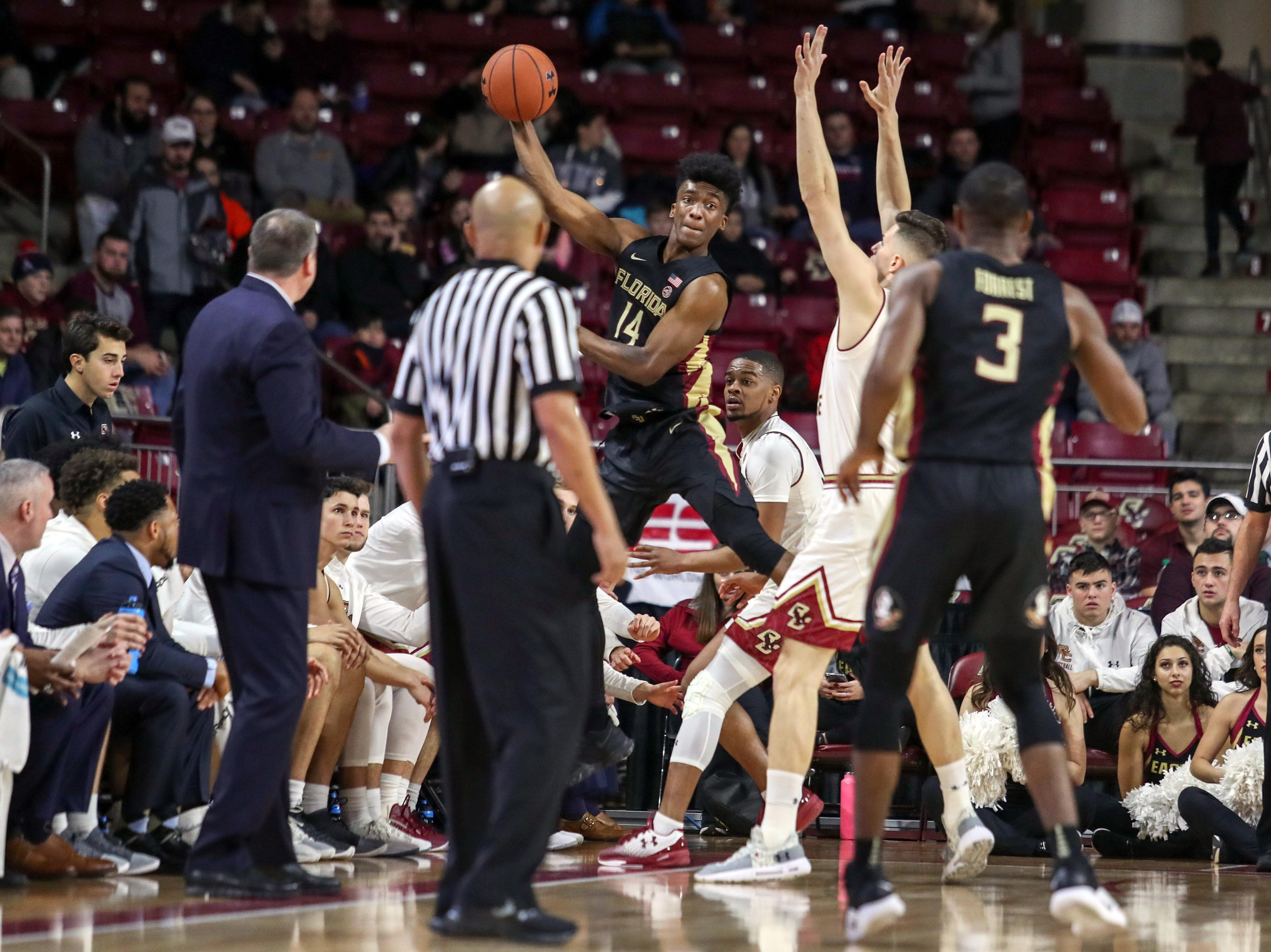 Jan 20, 2019; Chestnut Hill, MA, USA; Florida State Seminoles guard Terance Mann (14) saves the ball against the Boston College Eagles during the first half at Conte Forum. Mandatory Credit: Paul Rutherford-USA TODAY Sports