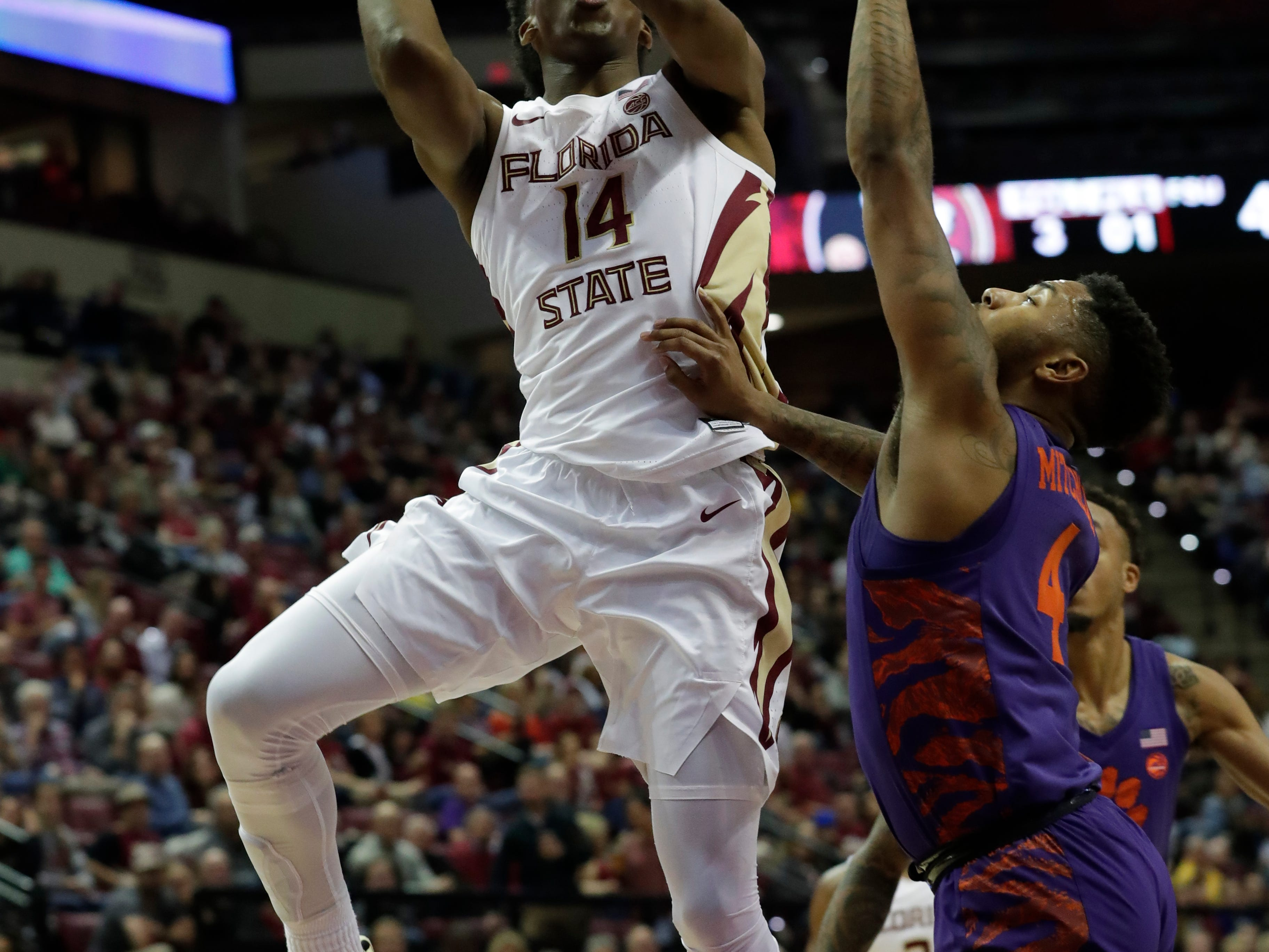 Florida State Seminoles guard Terance Mann (14) shoots for two while Clemson Tigers guard Shelton Mitchell (4) tries to block his shot. The Florida State Seminoles face off against the Clemson Tigers at the Tucker Civic Center, Tuesday, Jan. 22, 2019.
