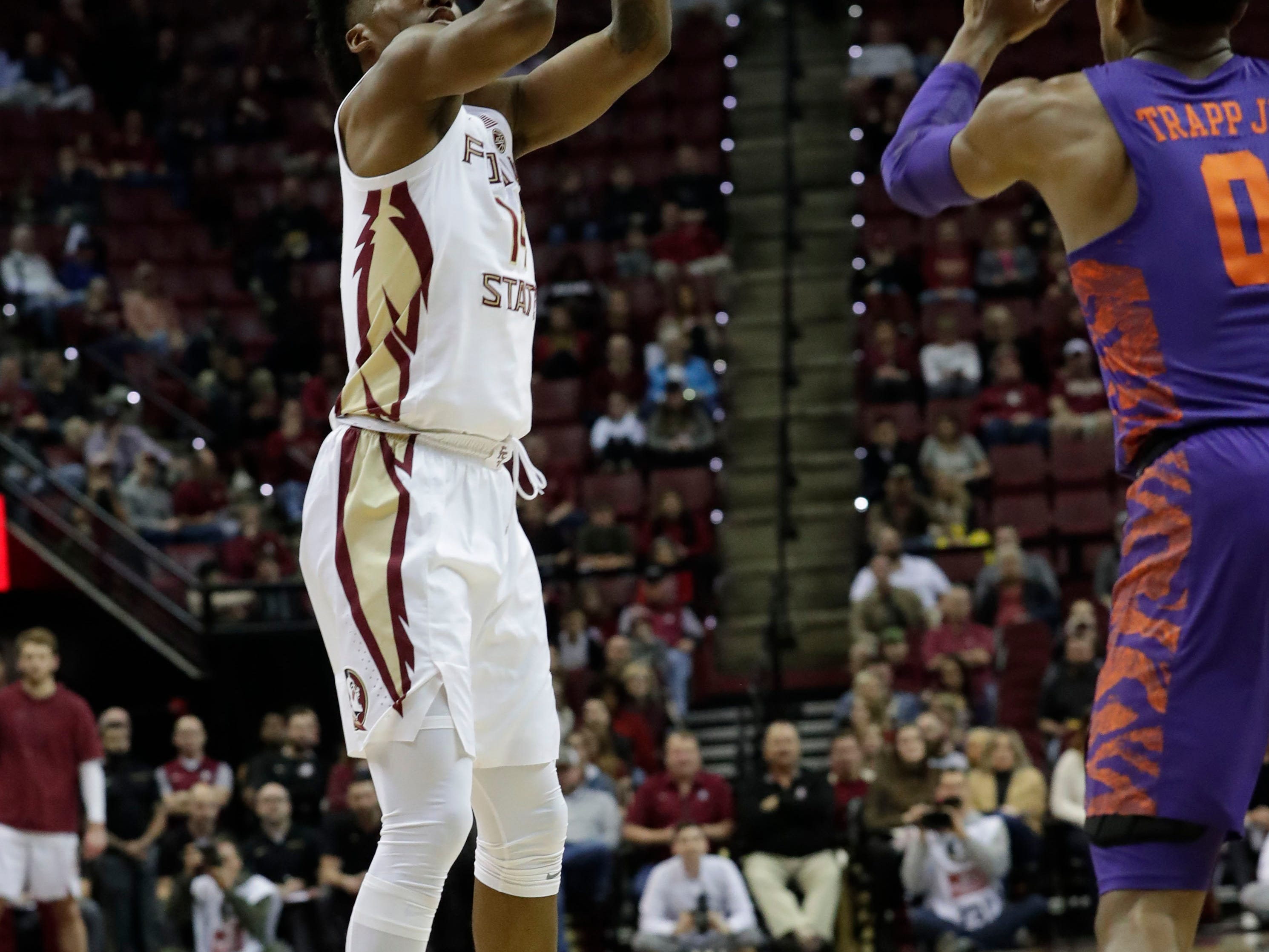 Florida State Seminoles guard Terance Mann (14) shoots for three over Clemson Tigers guard Clyde Trapp (0). The Florida State Seminoles face off against the Clemson Tigers at the Tucker Civic Center, Tuesday, Jan. 22, 2019.