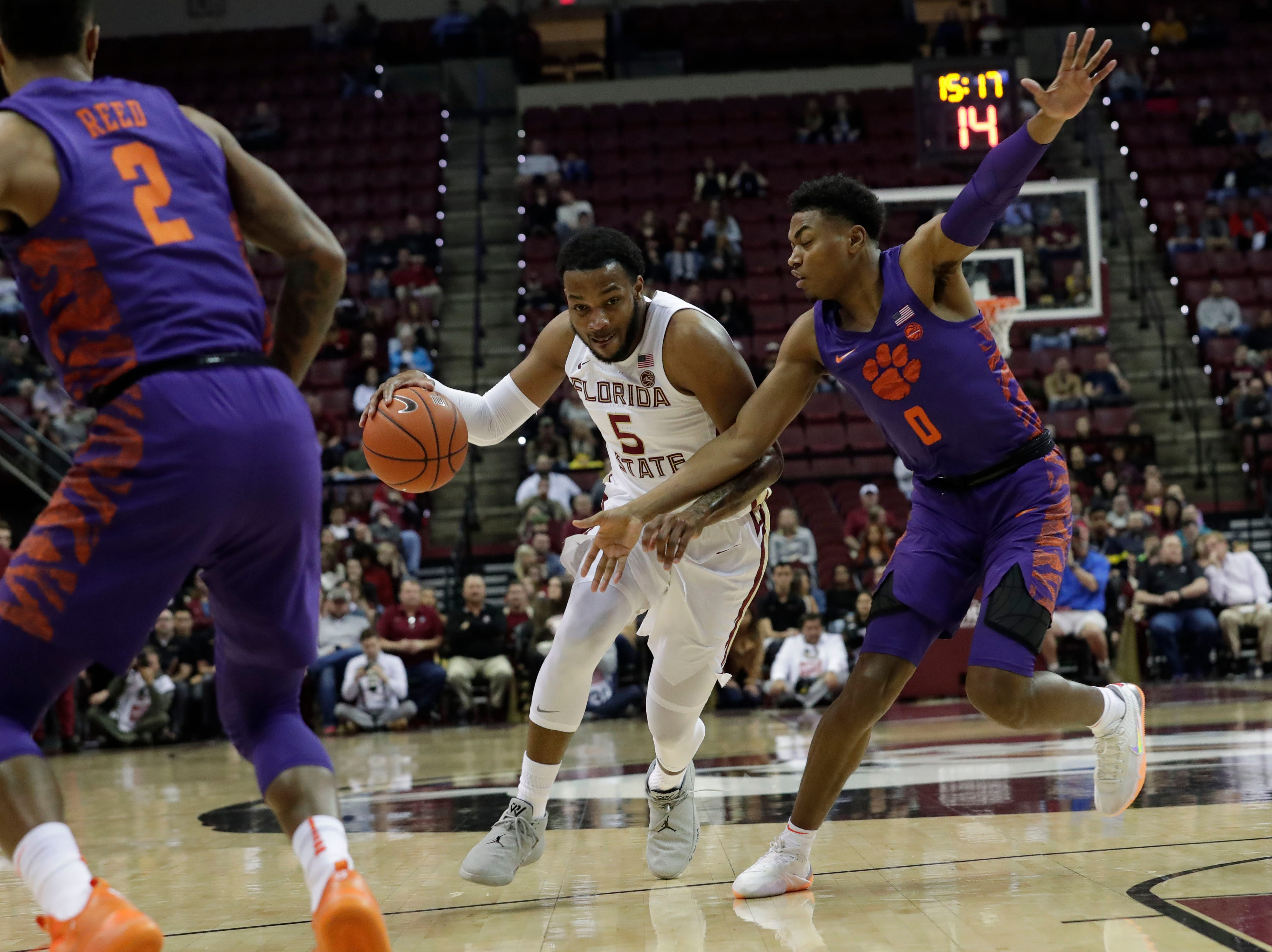 Florida State Seminoles guard PJ Savoy (5) drives the ball to the hoop while making his way around Clemson Tigers guard Clyde Trapp (0). The Florida State Seminoles face off against the Clemson Tigers at the Tucker Civic Center, Tuesday, Jan. 22, 2019.