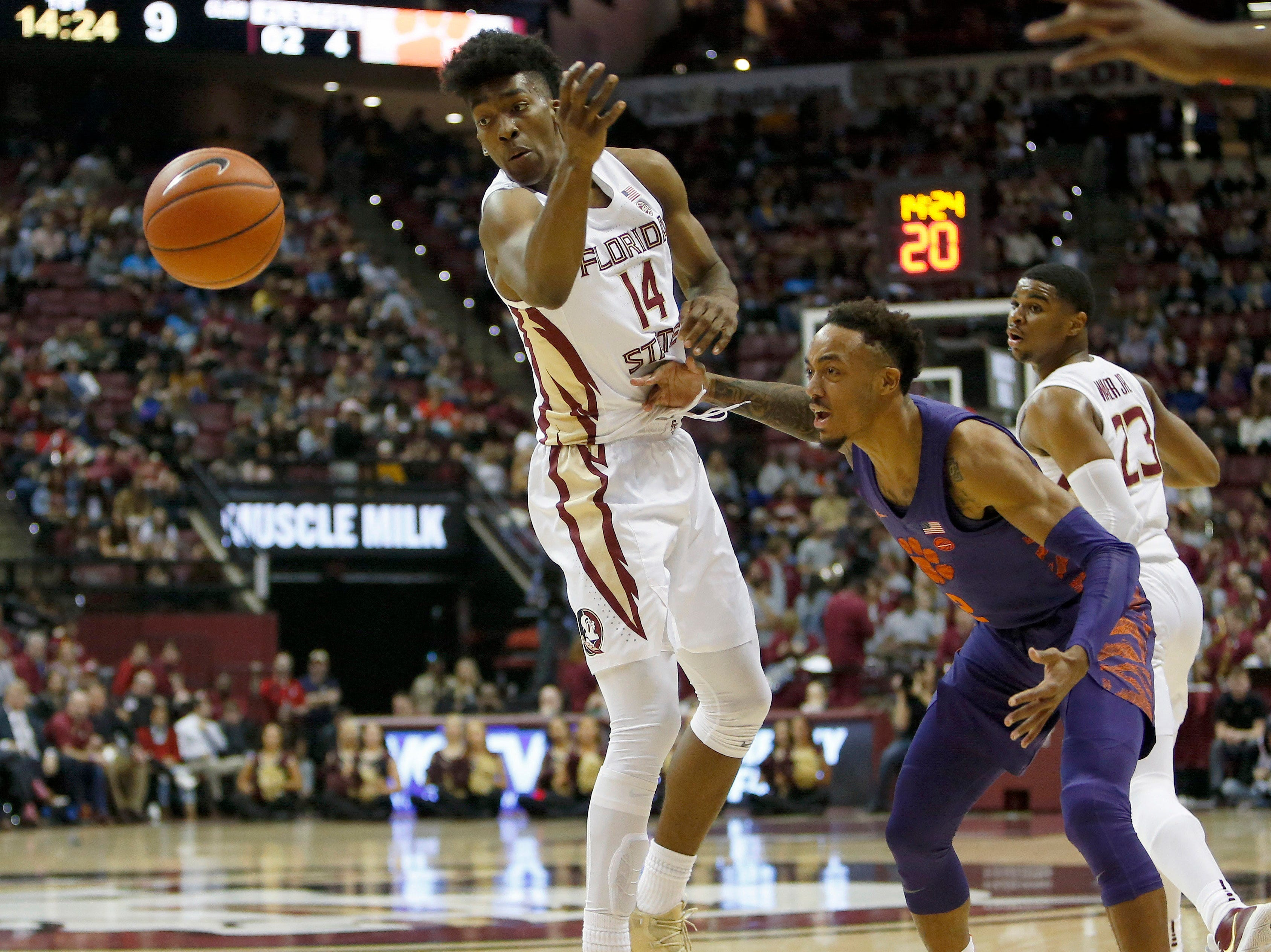 Jan 22, 2019; Tallahassee, FL, USA; Clemson Tigers guard Marcquise Reed (2) passes the ball against Florida State Seminoles guard Terance Mann (14) during the first half at Donald L. Tucker Center. Mandatory Credit: Glenn Beil-USA TODAY Sports
