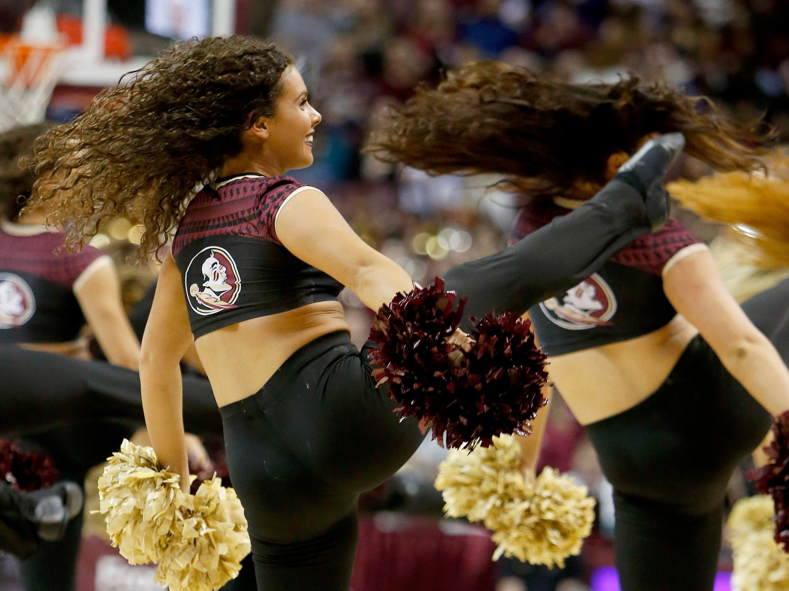 Jan 22, 2019; Tallahassee, FL, USA; A Florida State Seminoles Golden Girl performs during a timeout during the first half against the Clemson Tigers at Donald L. Tucker Center. Mandatory Credit: Glenn Beil-USA TODAY Sports
