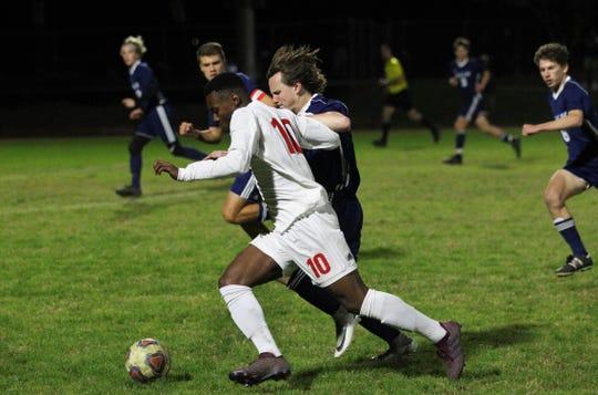 Leon's Jaden Jones-Riley races past Maclay's Bryce Valveri as Leon's boys soccer team beat Maclay 3-1 on Jan. 22, 2019.