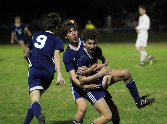 Maclay sophomore Drew Daunt celebrates a goal by jumping into the arms of teammate Luke Stockstill, but Leon's boys soccer team beat Maclay 3-1 on Jan. 22, 2019.