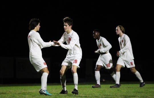 Leon's Antonio Nunez (19) celebrates a goal with Henry Regalado as Leon's boys soccer team beat Maclay 3-1 on Jan. 22, 2019.