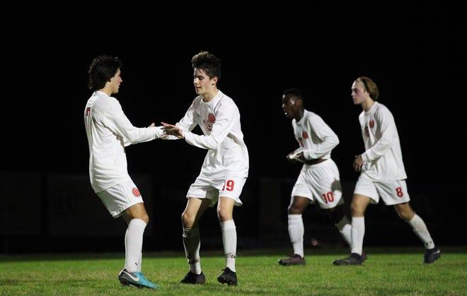 Leon's Antonio Nunez (19) celebrates a goal with Henry Regalado as Leon's boys soccer team beat Maclay 3-1 on Jan. 22, 2019.